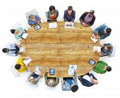 Diverse People Working Around the Conference Table