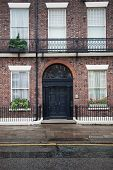 House with brick facade and doorway