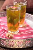 Moroccan mint tea and brown sugar on a tray