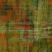 art abstract colorful silk textured blurred background in green, red, orange and gold colors