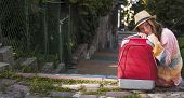 Young beautiful girl and red suitcase, travel concept.