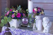 Flower Arrangement In A Basket Decorate The Wedding Table In Purple Tones. Vintage. Flowers, Candles