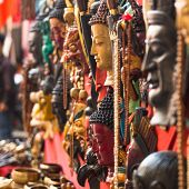 KATHMANDU, NEPAL - NOV 29, 2013: Masks, souvenirs in street shop at Durbar Square. Preference for co