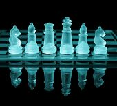Chess pieces on check board with reflection and blue tone