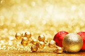 Colorful christmas decoration on shiny golden background