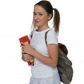 Young schoolgirl with her hair in pigtails and a backpack over her shoulder grimacing as she leaves