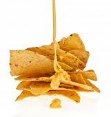 pic of nachos  - Salted corn chip nacho snack with cheese sauce isolated on white background - JPG