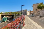 JERUSALEM, ISRAEL - JULY 10, 2014: Pedestrian walkway and urban road near Jaffa Gate - one of eight