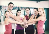 fitness, sport, training, gym and lifestyle concept - group of happy people in the gym celebrating v