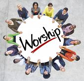Group of People Holding Hands Around the Word Worship