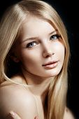Woman face close up. A pretty young blond trendy. Girl with a beauty face. Beautiful female face wit