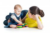 Little Girl And Mother With Building Blocks