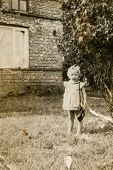 LODZ, POLAND, CIRCA FIFTIES - Vintage photo of little girl