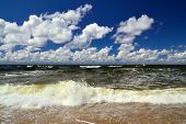 Surf And Cumulus Clouds