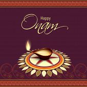 Beautiful oil lit lamp on beautiful floral decorated background with golden text Happy Onam on flora