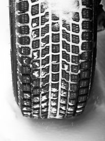 image of mud pack  - Mud and snow tire tread packed with snow - JPG