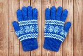 Knitted Mittens On A Wooden Background