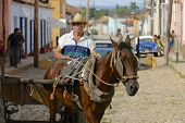 Man drives horse driven carriage, Trinidad, Cuba.