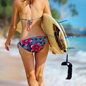 picture of board-walk  - Close up shot of the young lady walking with surf board on sandy tropical beach - JPG