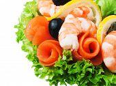 Shrimp And Salmon. Garnished With Fresh Raw Salad Leaf.