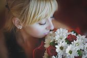 Girl Looks At A Bouquet