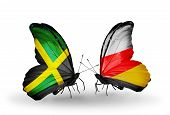Two Butterflies With Flags On Wings As Symbol Of Relations Jamaica And South Ossetia
