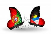 Two Butterflies With Flags On Wings As Symbol Of Relations Portugal And Antigua And Barbuda
