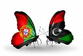 stock photo of libya  - Two butterflies with flags on wings as symbol of relations Portugal and Libya - JPG