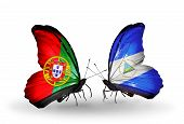 Two Butterflies With Flags On Wings As Symbol Of Relations Portugal And Nicaragua