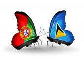 Two Butterflies With Flags On Wings As Symbol Of Relations Portugal And  Saint Lucia
