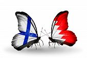 image of bahrain  - Two butterflies with flags on wings as symbol of relations Finland and Bahrain - JPG
