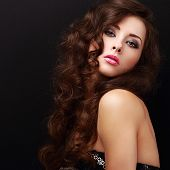 Beautiful Makeup Woman With Curly Hair Looking