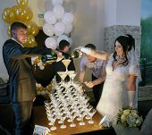 Buzuluk, Russia - September 19, 2014: The Wedding. The Couple Poured Champagne Into The Glasses.
