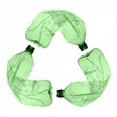 three green plastic bottles forming the symbol of recycling