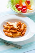 Penne pasta in tomato sauce with green salad