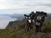 Baikal, Russia - August 13, 2012: The Landscape Of Nature. Motorcycles Are Near The Lake.
