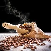 Roasted coffee beans in linen bag