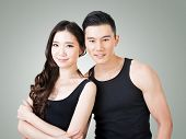 Young Asian sport couple, closeup portrait.