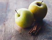 foto of cinnamon sticks  - Apples and cinnamon sticks - JPG