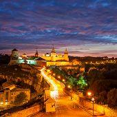 Night view of medieval half-ruined castle in Kamenetz-Podolsk, Ukraine