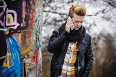 Man Talking On Mobile Phone Outdoor