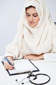 Arabic Female Doctor During Working