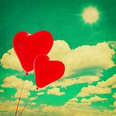 Blue Sky With White Clouds And Red Heart Shaped Balloons