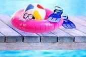 Bright beach accessories on sea background
