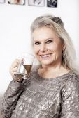 An image of a best age woman with a cup of tea