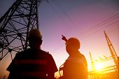 image of substation  - two worker watching the power tower and substation with sunset background - JPG