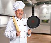 Senior professional chef man in modern kitchen