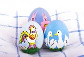 stock photo of duck egg blue  - Hand painted Easter eggs in bright colors with rooster - JPG