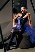 Woman wearing sexy purple dress