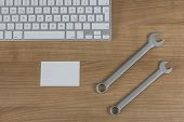 Keyboard And Wrenches On Desktop
